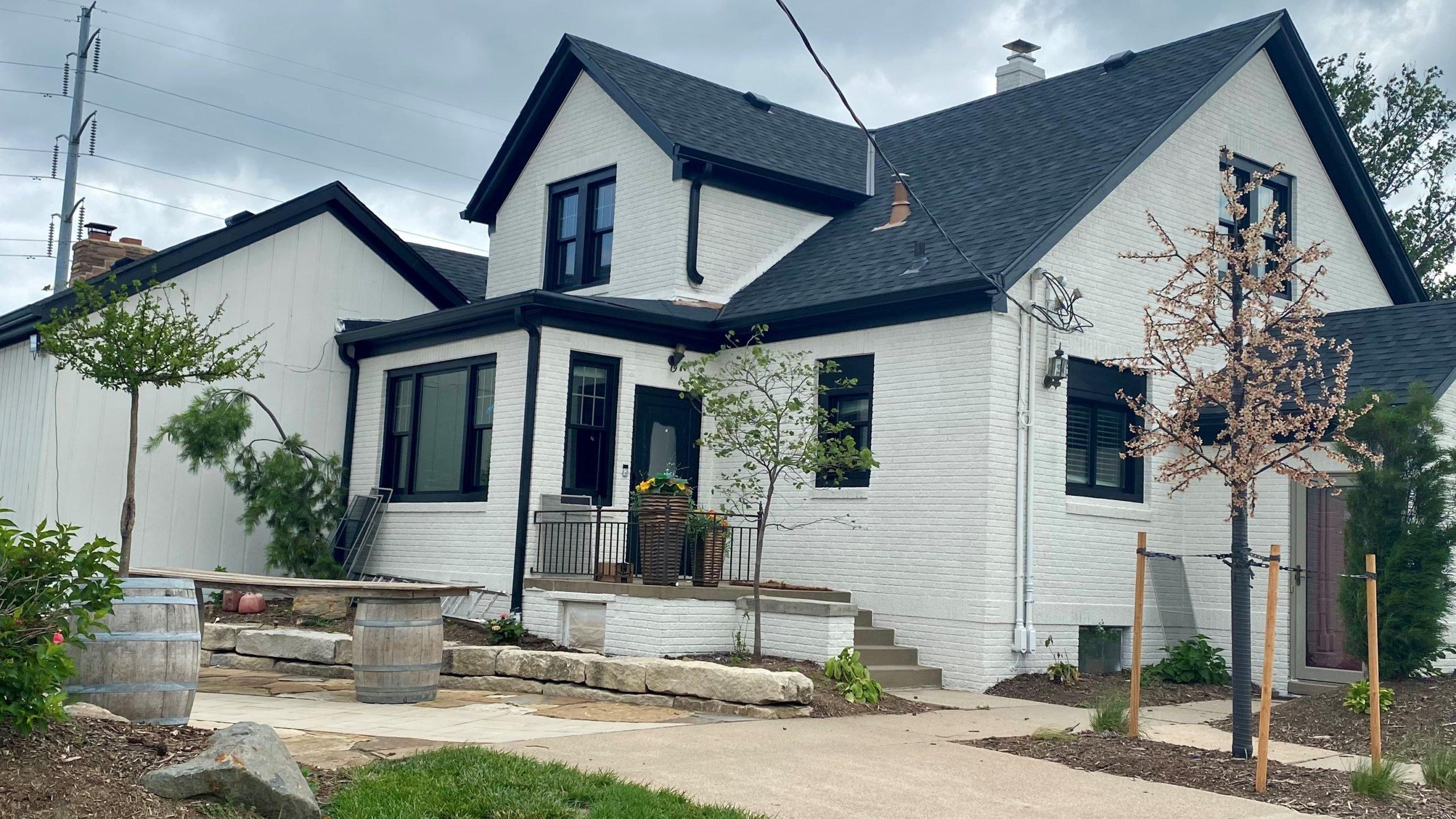 black asphalt shingles and exterior paint